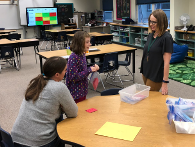 Kenny Lake School teacher Jennifer Hodges (Grades 3-4-5) walked parents through a typical math lesson in her combined-grades classroom during the Family Fun Night on October 16th.